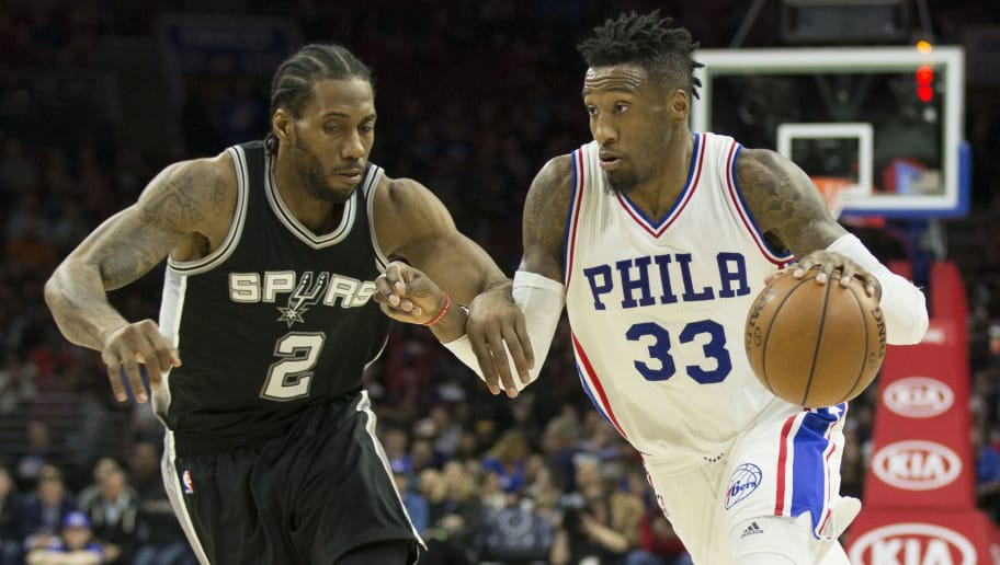 PHILADELPHIA, PA - FEBRUARY 8: Robert Covington #33 of the Philadelphia 76ers drives to the basket against Kawhi Leonard #2 of the San Antonio Spurs at the Wells Fargo Center on February 8, 2017 in Philadelphia, Pennsylvania. The Spurs defeated the 76ers 111-103. NOTE TO USER: User expressly acknowledges and agrees that, by downloading and or using this photograph, User is consenting to the terms and conditions of the Getty Images License Agreement. (Photo by Mitchell Leff/Getty Images)