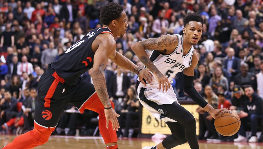 TORONTO, ON - JANUARY 19: Dejounte Murray #5 of the San Antonio Spurs drives against DeMar DeRozan #10 of the Toronto Raptors in an NBA game at the Air Canada Centre on January 19, 2018 in Toronto, Ontario, Canada. The Raptors defeated the Spurs 86-83. NOTE TO USER: User expressly acknowledges and agrees by downloading and/or using this Photograph, user is consenting to the terms and conditions of the Getty Images Licence Agreement. (Photo by Claus Andersen/Getty Images)