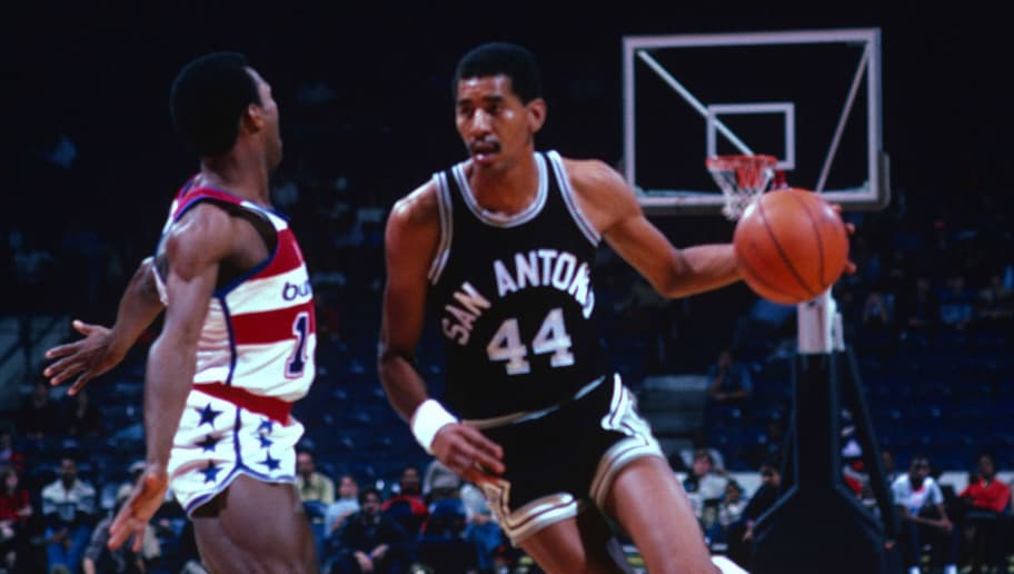 LANDOVER, MD - CIRCA 1982: George Gervin #44 of the San Antonio Spurs drives on Frank Johnson #15 of the Washington Bullets during an NBA basketball game circa 1982 at the Capital Centre in Landover, Maryland. Gervin played for the Spurs from 1974-85. (Photo by Focus on Sport/Getty Images)