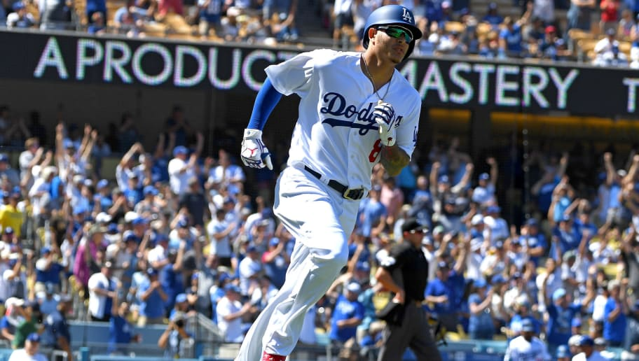 LOS ANGELES, CA - SEPTEMBER 23:  Manny Machado #8 of the Los Angeles Dodgers rounds the bases after hitting a solo home run in the second inning of the game against the San Diego Padres at Dodger Stadium on September 23, 2018 in Los Angeles, California.  (Photo by Jayne Kamin-Oncea/Getty Images)