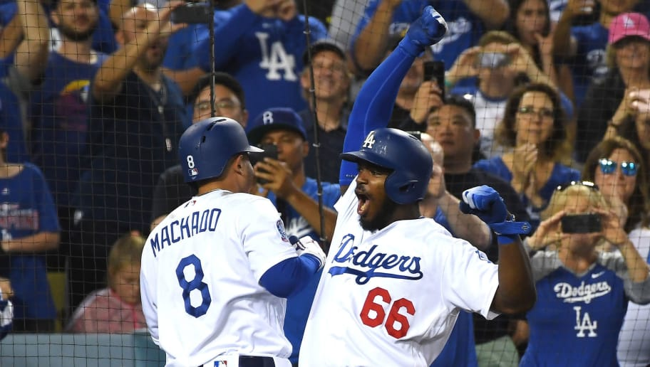 LOS ANGELES, CA - SEPTEMBER 22:  Manny Machado #8 of the Los Angeles Dodgers celebrates with teammate Yasiel Puig #66 after hitting a three-run home run in the third inning against the San Diego Padres at Dodger Stadium on September 22, 2018 in Los Angeles, California.  (Photo by Jayne Kamin-Oncea/Getty Images)