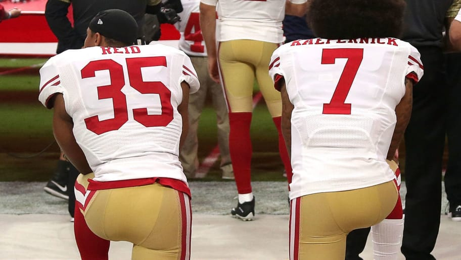 GLENDALE, AZ - NOVEMBER 13: Free safety Eric Reid #35 of the San Francisco 49ers and quarterback Colin Kaepernick #7 kneel during the national anthem before the start of the NFL football game against the Arizona Cardinals at University of Phoenix Stadium on November 13, 2016 in Glendale, Arizona. (Photo by Chris Coduto/Getty Images)