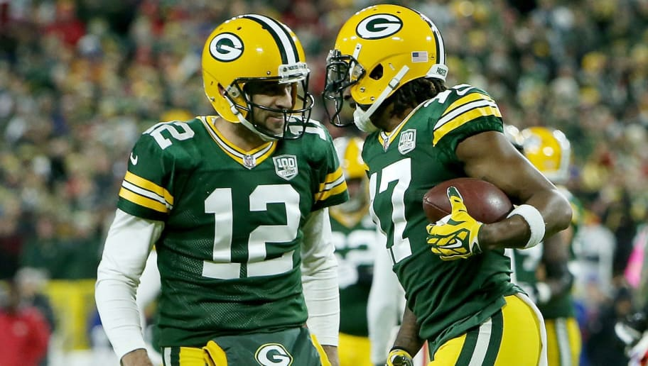 GREEN BAY, WI - OCTOBER 15:  Aaron Rodgers #12 and Davante Adams #17 of the Green Bay Packers celebrate after scoring a touchdown in the first quarter against the San Francisco 49ers at Lambeau Field on October 15, 2018 in Green Bay, Wisconsin.  (Photo by Dylan Buell/Getty Images)