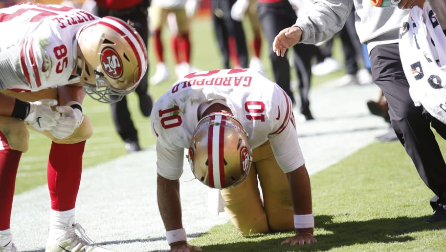 KANSAS CITY, MO - SEPTEMBER 23: Jimmy Garoppolo #10 of the San Francisco 49ers gets look at after injuring his ACL during the game against the Kansas City Chiefs at Arrowhead Stadium on September 23, 2018 in Kansas City, Missouri. The Chiefs defeated the 49ers 38-27. (Photo by Michael Zagaris/San Francisco 49ers/Getty Images)