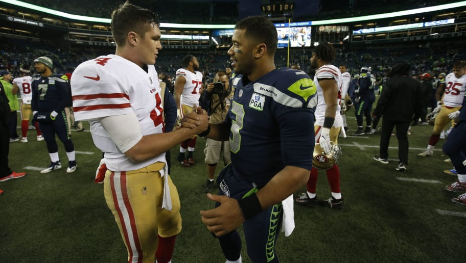 SEATTLE, WA - DECEMBER 2: Nick Mullens #4 of the San Francisco 49ers and Russell Wilson #3 of the Seattle Seahawks talk on the field following the game at CenturyLink Field on December 2, 2018 in Seattle, Washington. The Seahawks defeated the 49ers 43-16. (Photo by Michael Zagaris/San Francisco 49ers/Getty Images)
