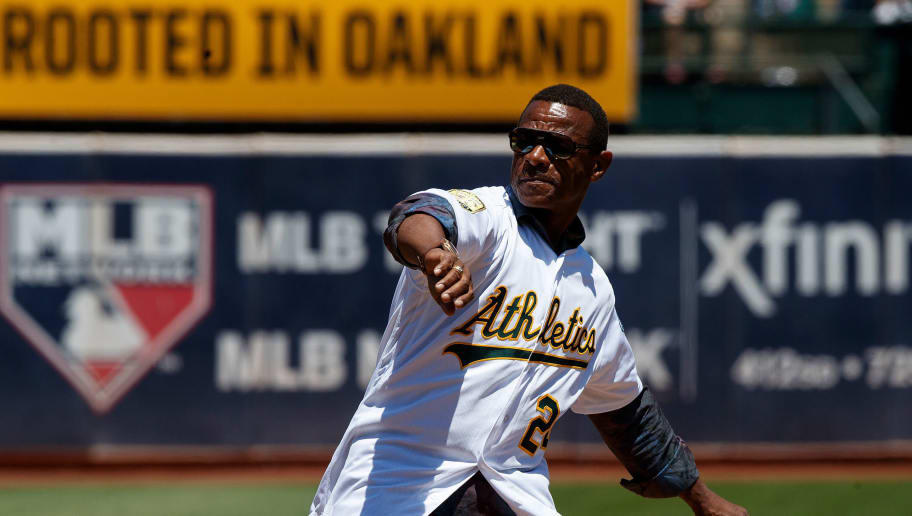 OAKLAND, CA - JULY 22:  Former Oakland Athletics outfielder Rickey Henderson throws out the ceremonial first pitch before the game against the San Francisco Giants at the Oakland Coliseum on July 22, 2018 in Oakland, California. The Oakland Athletics defeated the San Francisco Giants 6-5 in 10 innings. (Photo by Jason O. Watson/Getty Images)