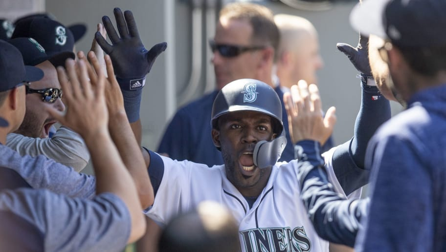 SEATTLE, WA - JULY 25: Guillermo Heredia #5 of the Seattle Mariners celebrates with teammates in the dugout after scoring a run on a hit by Jean Segura off of relief pitcher Sam Dyson of the San Francisco Giants during the eighth inning of a game at Safeco Field on July 25, 2018 in Seattle, Washington. The Mariners won  3-2. (Photo by Stephen Brashear/Getty Images)