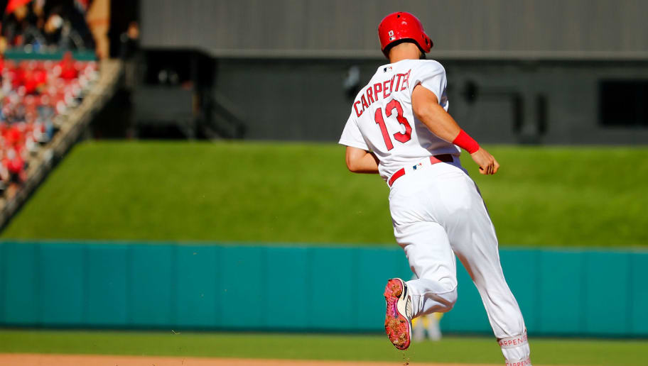 ST. LOUIS, MO - SEPTEMBER 23: Matt Carpenter #13 of the St. Louis Cardinals rounds first base after hitting a two-run home run against the San Francisco Giants in the eighth inning at Busch Stadium on September 23, 2018 in St. Louis, Missouri.  (Photo by Dilip Vishwanat/Getty Images)