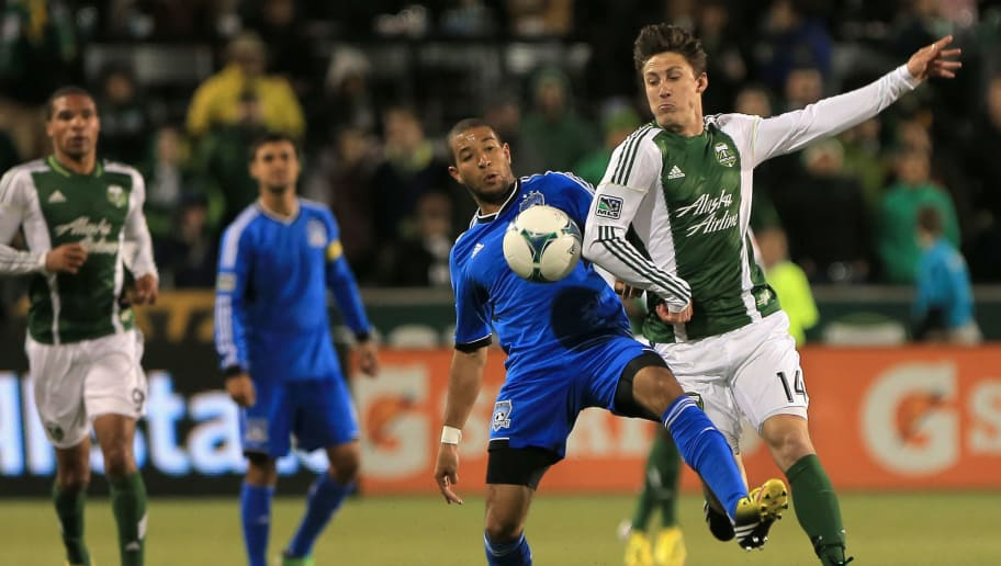 PORTLAND, OR - APRIL 14:  Justin Morrow #15 of the San Jose Earthquakes and Ben Zemanski #14 of the Portland Timbers battle for control of the ball at JELD-WEN Field on April 14, 2013 in Portland, Oregon. The Timbers defeated the Earthquakes 1-0.  (Photo by Doug Pensinger/Getty Images)