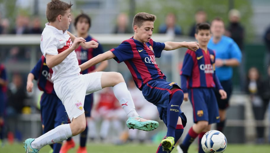 MOENCHENGLADBACH, GERMANY - APRIL 26:  Robert Navarro Munoz (R) of Barcelona in action during the Final of the Santander Cup for U13 teams between FC Barcelona and VfB Stuttgart at Borussia Park Fohlenplatz on April 26, 2015 in Moenchengladbach, Germany.  (Photo by Matthias Hangst/Bongarts/Getty Images)