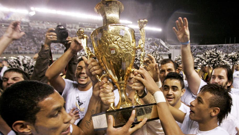 SANTOS, BRAZIL - MAY 15:  Neymar (R) of Santos celebrates after winning the 2011 Sao Paulo State Championship at Vila Belmiro stadium on May 15, 2011 in Santos, Brazil. (Photo by Eduardo Anizelli/LatinContent/Getty Images)