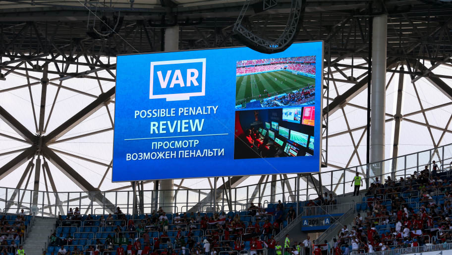VOLGOGRAD, RUSSIA - JUNE 25: A VAR decision is seen on the big LCD screen in Volgograd Arena as a penalty decision is reviewed during the 2018 FIFA World Cup Russia group A match between Saudia Arabia and Egypt at Volgograd Arena on June 25, 2018 in Volgograd, Russia. (Photo by Robbie Jay Barratt - AMA/Getty Images)