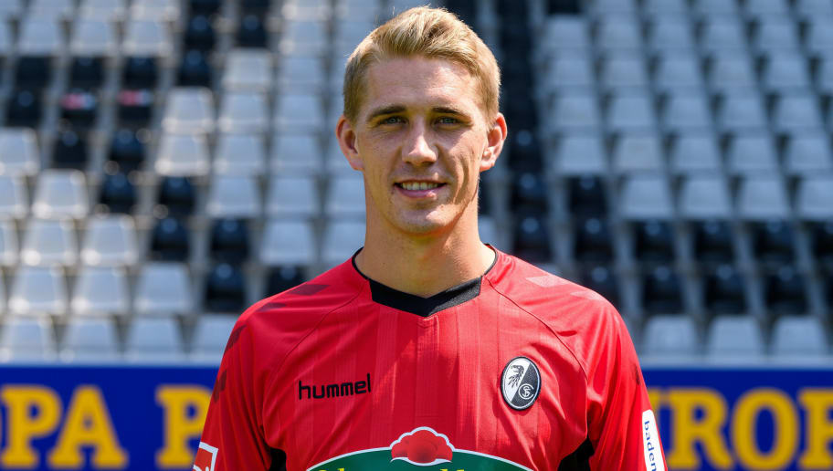 FREIBURG IM BREISGAU, GERMANY - AUGUST 07: Nils Petersen of SC Freiburg poses during the team presentation on August 7, 2018 in Freiburg im Breisgau, Germany. (Photo by Alexander Scheuber/Bongarts/Getty Images)