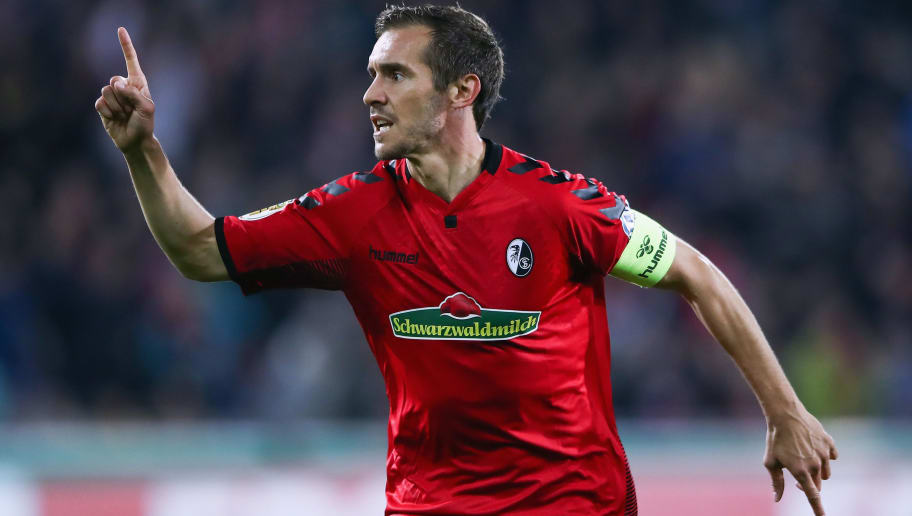 FREIBURG IM BREISGAU, GERMANY - OCTOBER 25: Julian Schuster of Freiburg celebrates his team's second goal during the DFB Cup match between SC Freiburg and Dynamo Dresden at Schwarzwald-Stadion on October 25, 2017 in Freiburg im Breisgau, Germany.  (Photo by Alex Grimm/Bongarts/Getty Images)