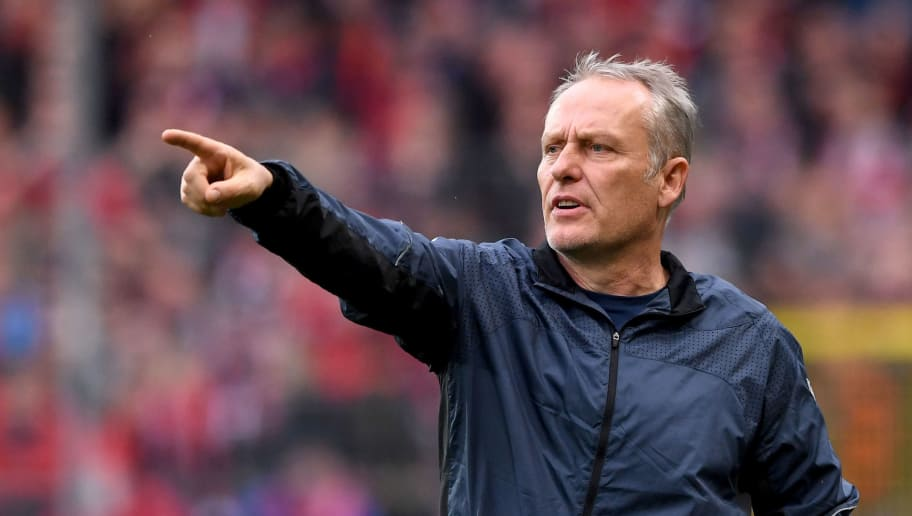 FREIBURG GERMANY - NOVEMBER 10: Headcoach Christian Streich of SC Freiburg reacts during the Bundesliga match between Sport Club Freiburg and Mainz 05 at Schwarzwald-Stadion on November 10, 2018 in Freiburg, Germany.  (Photo by Michael Kienzler/Bongarts/Getty Images)