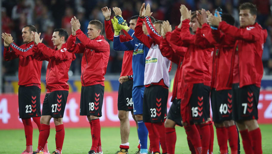 FREIBURG IM BREISGAU, GERMANY - JULY 27: Nils Petersen #18 and team mates of Freiburg celebrate with the fans after the UEFA Europa League Third Qualifying Round first leg match between SC Freiburg and NK Domzale at Schwarzwald-Stadion on July 27, 2017 in Freiburg im Breisgau, Germany.  (Photo by Alex Grimm/Bongarts/Getty Images)