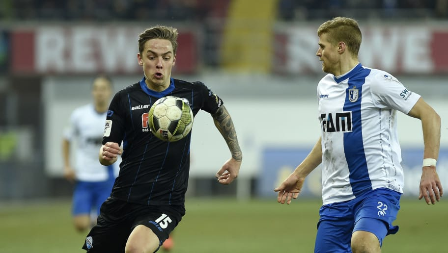 PADERBORN, GERMANY - MARCH 06: Phillip Tietz of Paderborn and Andre Hainault of Magdeburg battle for the ball during the 3. Liga match between SC Paderborn 07 and 1. FC Magdeburg at Benteler-Arena on March 6, 2018 in Paderborn, Germany. (Photo by TF-Images/TF-Images via Getty Images)