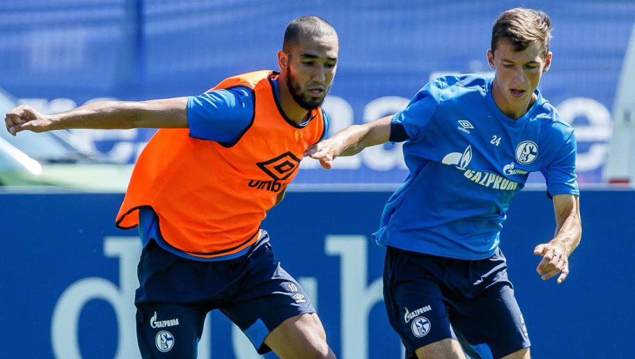 MITTERSILL, AUSTRIA - JULY 31: Nabil Bentalep of Schalke and Bastian Oczipka of Schalke battle for the ball during the Schalke 04 Training Camp on July 31, 2018 in Mittersill, Austria. (Photo by TF-Images/Getty Images)