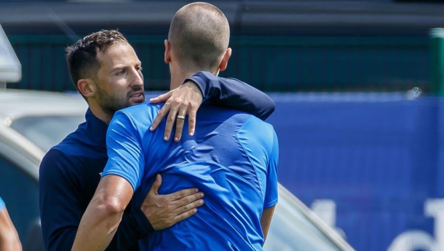 MITTERSILL, AUSTRIA - AUGUST 01: Head coach Domenico Tedesco of Schalke hugs Matija Nastasic of Schalke during the Schalke 04 Training Camp on August 1, 2018 in Mittersill, Austria. (Photo by TF-Images/Getty Images)