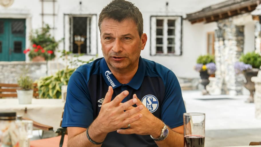MITTERSILL, AUSTRIA - AUGUST 05: Sporting director Christian Heidel of Schalke gives an interview during the Schalke 04 Training Camp on August 5, 2018 in Mittersill, Austria. (Photo by TF-Images/Getty Images)