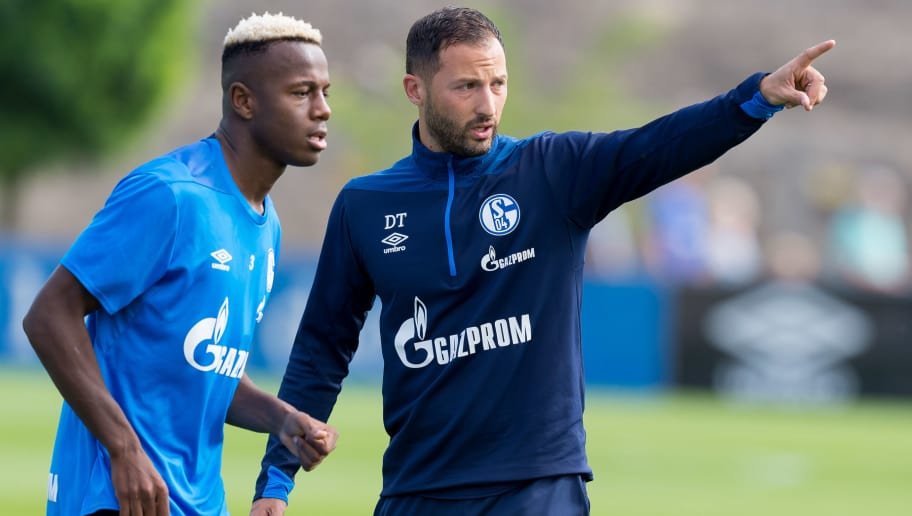 GELSENKIRCHEN, GERMANY - AUGUST 21: Hamza Mendyl of Schalke and Head coach Domenico Tedesco of Schalke during the Schalke 04 training session on August 21, 2018 in Gelsenkirchen, Germany. (Photo by TF-Images/Getty Images)