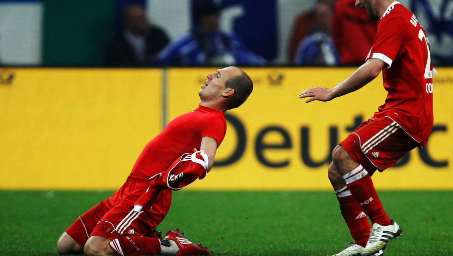 GELSENKIRCHEN, GERMANY - MARCH 24:  Arjen Robben of Muenchen (L) celebrates with team mates after scoring his team's first goal during the DFB Cup semi final match between FC Schalke 04 and FC Bayern Muenchen at Veltins Arena on March 24, 2010 in Gelsenkirchen, Germany.  (Photo by Lars Baron/Bongarts/Getty Images)