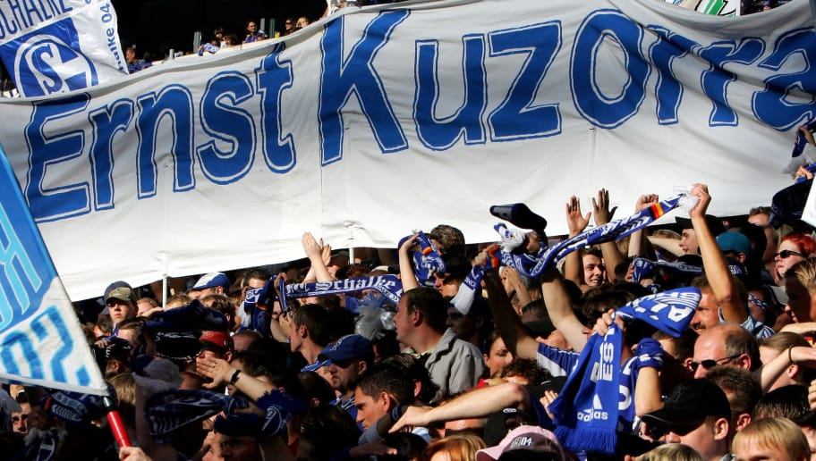 GELSENKIRCHEN, GERMANY - OCTOBER 15: The fans of Schalke show a banner with Ernst Kuzorra on it before the Bundesliga match between Schalke 04 and Bayern Munich at the Arena Auf Schalke on October 15, 2005 in Gelsenkirchen, Germany.  (Photo by Lars Baron/Bongarts/Getty Images)