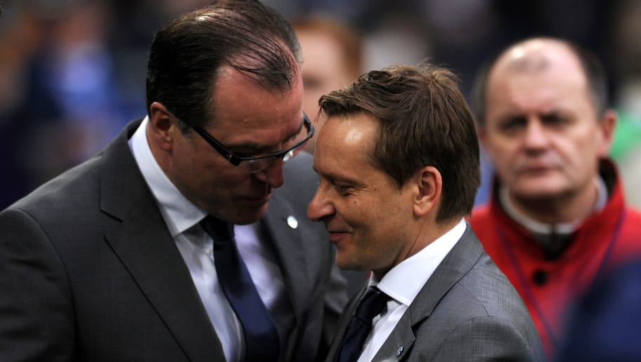 Schalke's manager Horst Heldt (R) and Sc