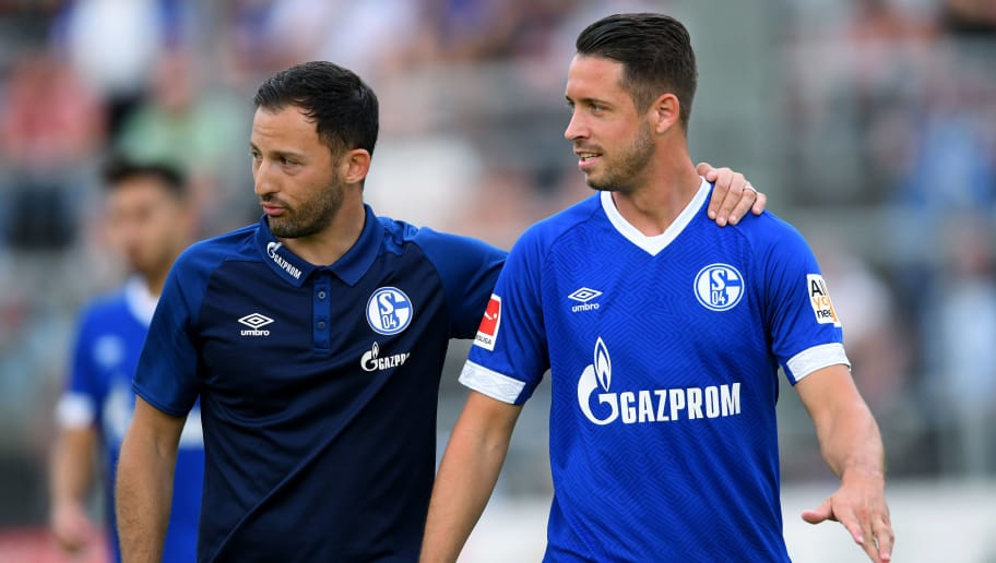 ESSEN, GERMANY - JULY 21: Head coach Domenico Tedesco of Schalke and Mark Uth of Schalke look on during the Friendly match between Schwarz Weiss Essen and FC Schalke 04 on July 21, 2018 in Essen, Germany. (Photo by TF-Images/Getty Images)