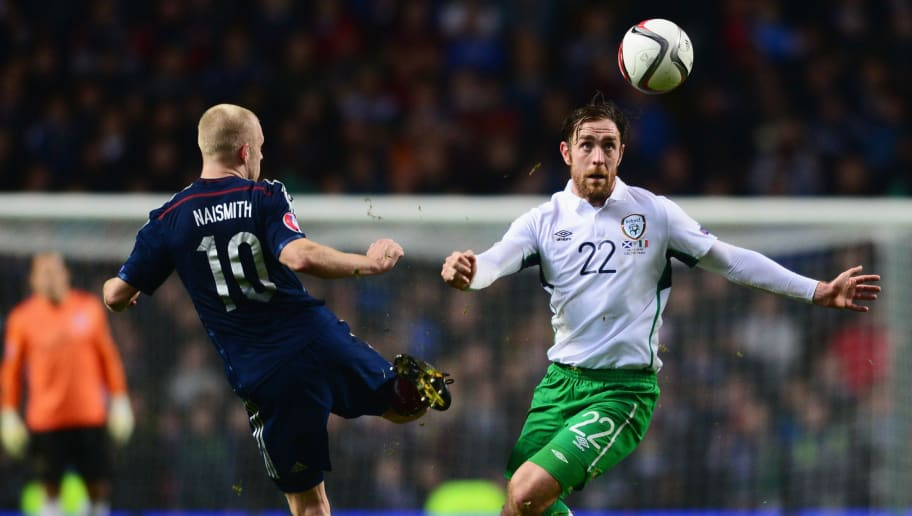 GLASGOW, SCOTLAND - NOVEMBER 14:  Richard Keogh of the Republic of Ireland beats Steven Naismith of Scotland to the ball during the EURO 2016 Group D Qualifier match between Scotland and Republic of Ireland at Celtic Park on November 14, 2014 in Glasgow, Scotland.  (Photo by Mark Runnacles/Getty Images)