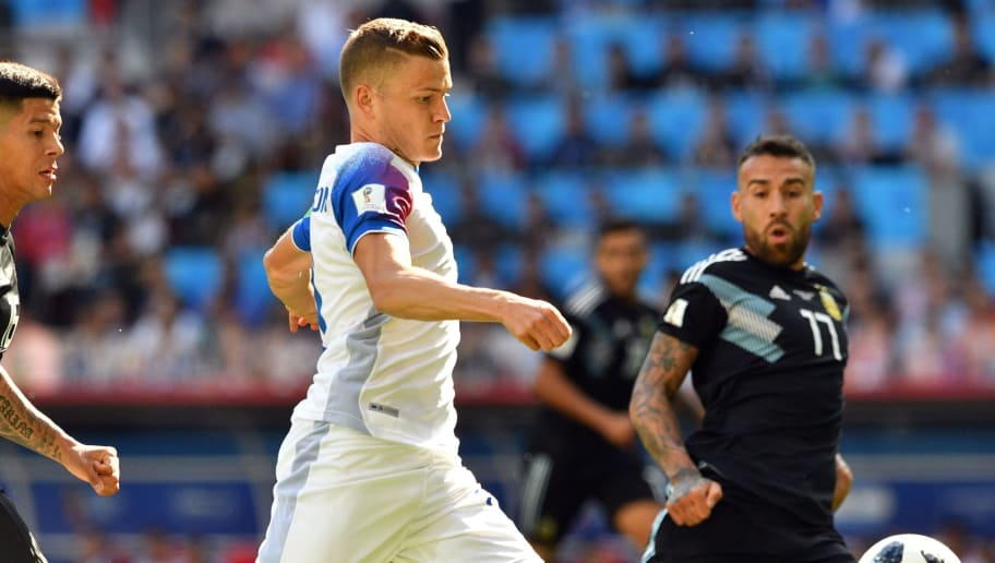 Iceland's forward Alfred Finnbogason (C) challenges Argentina's defender Nicolas Otamendi (R) and Argentina's defender Marcos Rojo during the Russia 2018 World Cup Group D football match between Argentina and Iceland at the Spartak Stadium in Moscow on June 16, 2018. (Photo by Mladen ANTONOV / AFP) / RESTRICTED TO EDITORIAL USE - NO MOBILE PUSH ALERTS/DOWNLOADS        (Photo credit should read MLADEN ANTONOV/AFP/Getty Images)