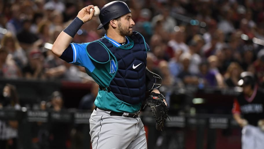 PHOENIX, AZ - AUGUST 25:  Mike Zunino #3 of the Seattle Mariners throws the ball back to the pitchers mound during a game against the Arizona Diamondbacks at Chase Field on August 25, 2018 in Phoenix, Arizona. All players across MLB will wear nicknames on their backs as well as colorful, non-traditional uniforms featuring alternate designs inspired by youth-league uniforms during Players Weekend.  (Photo by Norm Hall/Getty Images)