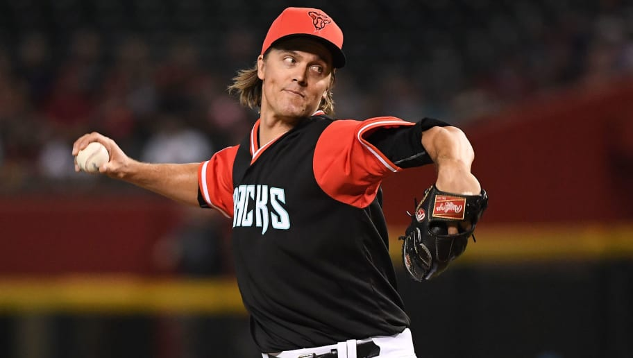 PHOENIX, AZ - AUGUST 26:  Zack Greinke #21 of the Arizona Diamondbacks delivers a pitch in the first inning of the MLB game against the Seattle Mariners at Chase Field on August 26, 2018 in Phoenix, Arizona. All players across MLB will wear nicknames on their backs as well as colorful, non-traditional uniforms featuring alternate designs inspired by youth-league uniforms during Players Weekend. (Photo by Jennifer Stewart/Getty Images)