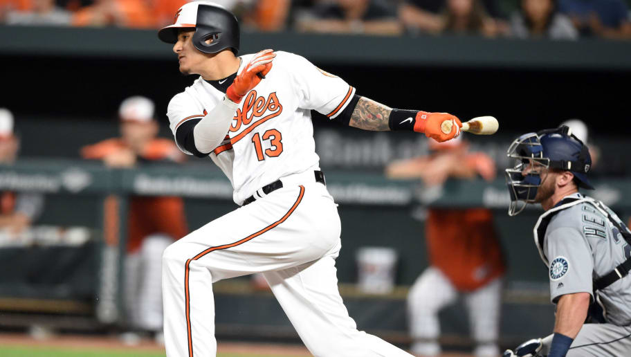 BALTIMORE, MD - JUNE 25:  Manny Machado #13 of the Baltimore Orioles bats during a baseball game against the Seattle Mariners at Oriole Park at Camden Yards on June 25, 2018 in Baltimore, Maryland.  (Photo by Mitchell Layton/Getty Images)