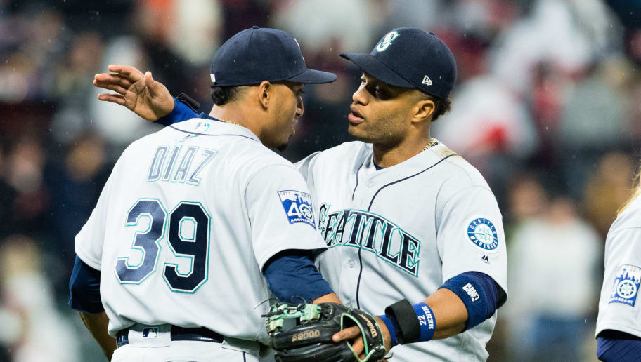 CLEVELAND, OH - APRIL 28: Closing pitcher Edwin Diaz #39 celebrates with Robinson Cano #22 of the Seattle Mariners after the Mariners defeated the Cleveland Indians at Progressive Field on April 28, 2017 in Cleveland, Ohio. The Mariners defeated the Indians 3-1. (Photo by Jason Miller/Getty Images)
