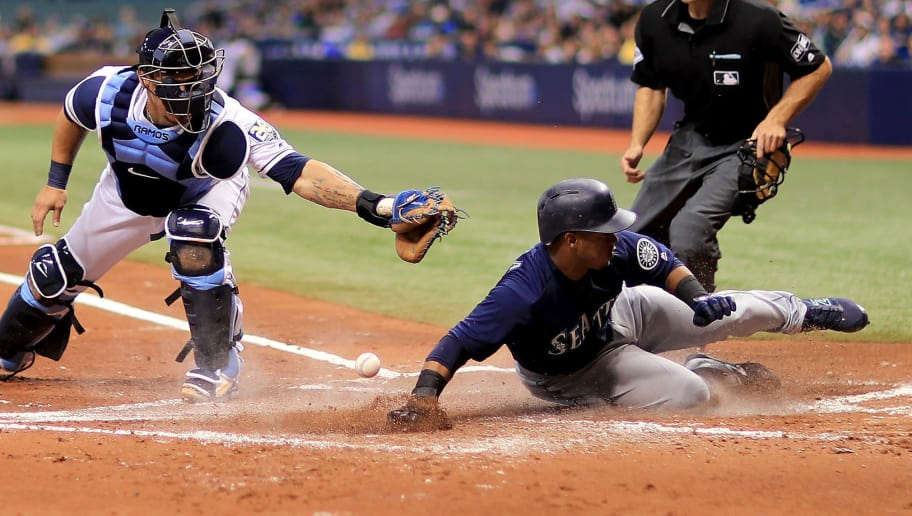 ST PETERSBURG, FL - JUNE 07:  Jean Segura #2 of the Seattle Mariners slides in front of the tag from Wilson Ramos #40 of the Tampa Bay Rays in the second inning during a game  at Tropicana Field on June 7, 2018 in St Petersburg, Florida.  (Photo by Mike Ehrmann/Getty Images)