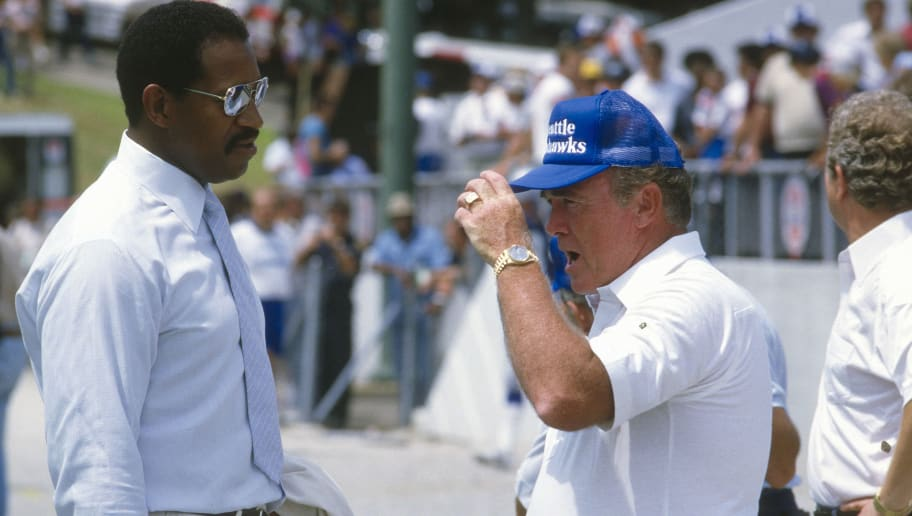 UNSPECIFIED - CIRCA 1983:  Head Coach Chuck Knox of the Seattle Seahawks talks with Gene Upshaw prior to the start of an NFL football game circa 1983. Knox coached the Seahawks from 1983-91. (Photo by Focus on Sport/Getty Images)