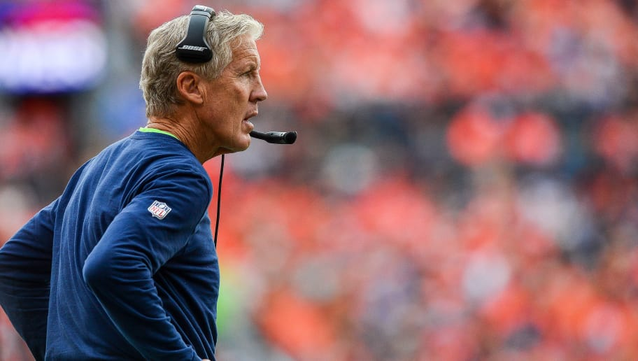 DENVER, CO - SEPTEMBER 9:  Head coach Pete Carroll of the Seattle Seahawks looks onto the field during a game against the Denver Broncos at Broncos Stadium at Mile High on September 9, 2018 in Denver, Colorado. (Photo by Dustin Bradford/Getty Images)