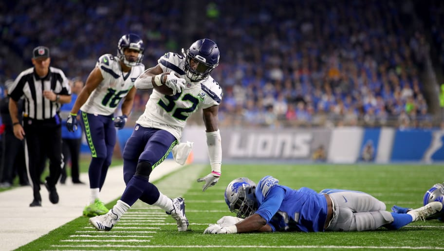 DETROIT, MI - OCTOBER 28: Christian Jones #52 of the Detroit Lions tries to tackle Chris Carson #32 of the Seattle Seahawks during the second half at Ford Field on October 28, 2018 in Detroit, Michigan. (Photo by Gregory Shamus/Getty Images)