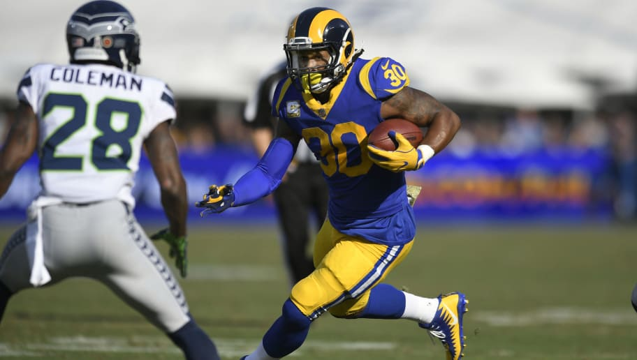 LOS ANGELES, CA - NOVEMBER 11: Todd Gurley #30 of the Los Angeles Rams rushes against the Seattle Seahawks at Los Angeles Memorial Coliseum on November 11, 2018 in Los Angeles, California. (Photo by John McCoy/Getty Images)