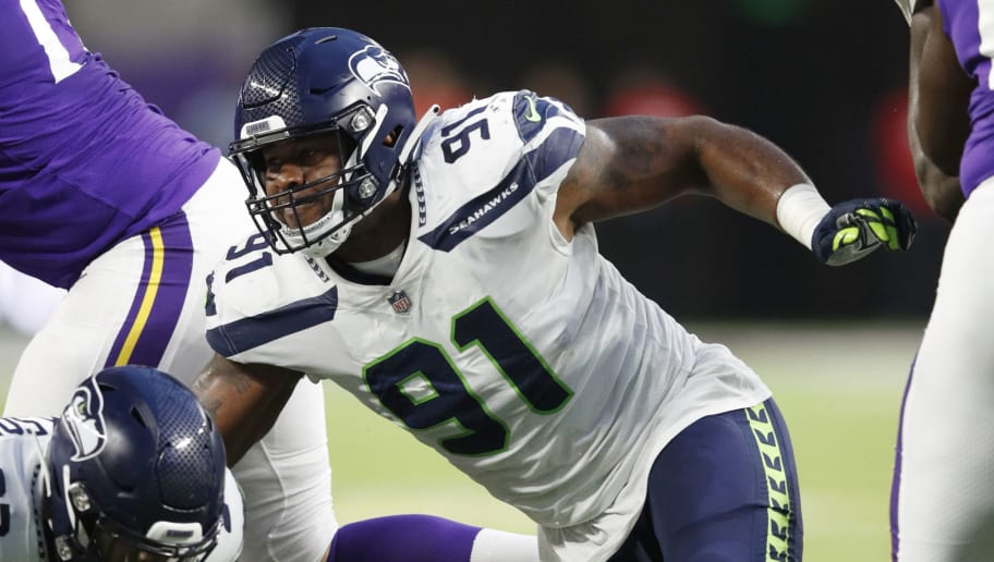 MINNEAPOLIS, MN - AUGUST 24: Tom Johnson #91 of the Seattle Seahawks in action during a preseason game against the Minnesota Vikings at U.S. Bank Stadium on August 24, 2018 in Minneapolis, Minnesota. (Photo by Joe Robbins/Getty Images)