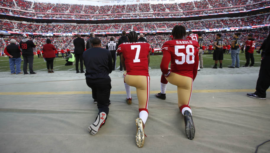 SANTA CLARA, CA - JANUARY 1: Eric Reid #35, Colin Kaepernick #7 and Eli Harold #58 of the San Francisco 49ers kneel on the sideline, during the anthem, prior to the game against the Seattle Seahawks at Levi Stadium on January 1, 2017 in Santa Clara, California. The Seahawks defeated the 49ers 25-23. (Photo by Michael Zagaris/San Francisco 49ers/Getty Images)