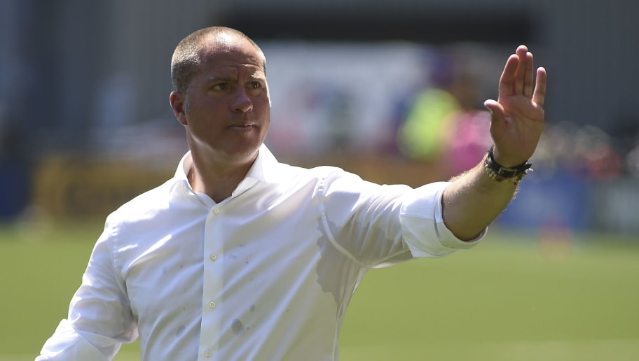 PORTLAND, OR - MAY 13:  Head coach Giovanni Savarese of the Portland Timbers waves to the crowd as he walks off the pitch during halftime of the match against the Seattle Sounders at Providence Park on May 13, 2018 in Portland, Oregon.  (Photo by Steve Dykes/Getty Images)