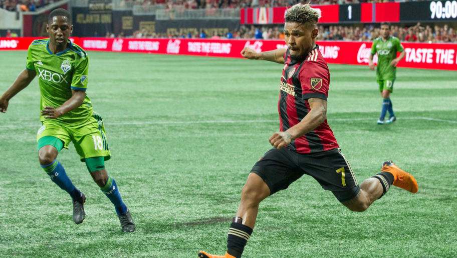ATLANTA, GA - JULY 15: Josef Martinez #7 of Atlanta United takes a shot in front of Kelvin Leerdam #18 of Seattle Sounders FC 2 during the game at Mercedes-Benz Stadium on July 15, 2018 in Atlanta, Georgia.  (Photo by Michael Chang/Getty Images)