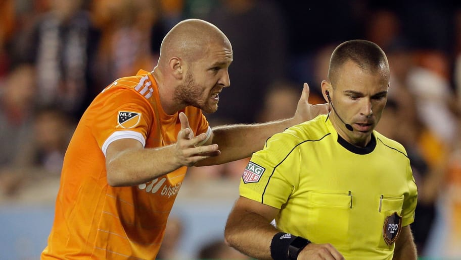 HOUSTON, TX - NOVEMBER 21:  Philippe Senderos #4 of Houston Dynamo argues with referee Chris Penso after a red card penalty was calleds on Jalil Anibaba #2 in the first half at BBVA Compass Stadium on November 21, 2017 in Houston, Texas.  (Photo by Bob Levey/Getty Images)