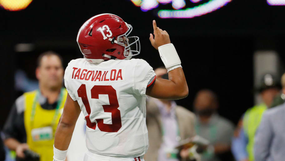 ATLANTA, GA - DECEMBER 01:  Tua Tagovailoa #13 of the Alabama Crimson Tide celebrates after a touchdown by Josh Jacobs #8 (not pictured) in the first half against the Georgia Bulldogs during the 2018 SEC Championship Game at Mercedes-Benz Stadium on December 1, 2018 in Atlanta, Georgia.  (Photo by Kevin C. Cox/Getty Images)