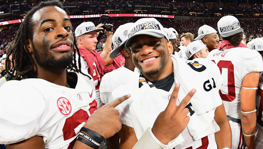 ATLANTA, GA - DECEMBER 01:  Tua Tagovailoa #13 of the Alabama Crimson Tide (R) reacts after defeating the Georgia Bulldogs 35-28 in the 2018 SEC Championship Game at Mercedes-Benz Stadium on December 1, 2018 in Atlanta, Georgia.  (Photo by Scott Cunningham/Getty Images)