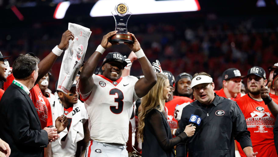 ATLANTA, GA - DECEMBER 02: Roquan Smith #3 of the Georgia Bulldogs reacts to winning the game MVP trophy after beating the Auburn Tigers in the SEC Championship at Mercedes-Benz Stadium on December 2, 2017 in Atlanta, Georgia. (Photo by Jamie Squire/Getty Images)
