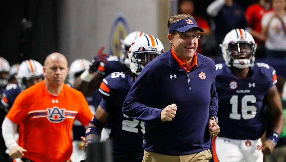 ATLANTA, GA - DECEMBER 02: Head coach Gus Malzahn of the Auburn Tigers runs out of the tunnel with his team prior to the game against the Auburn Tigers in the SEC Championship at Mercedes-Benz Stadium on December 2, 2017 in Atlanta, Georgia. (Photo by Kevin C.  Cox/Getty Images)
