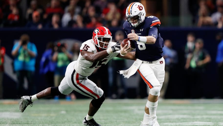 ATLANTA, GA - DECEMBER 02: Jarrett Stidham #8 of the Auburn Tigers is tackled by D'Andre Walker #15 of the Georgia Bulldogs during the second half in the SEC Championship at Mercedes-Benz Stadium on December 2, 2017 in Atlanta, Georgia. (Photo by Jamie Squire/Getty Images)